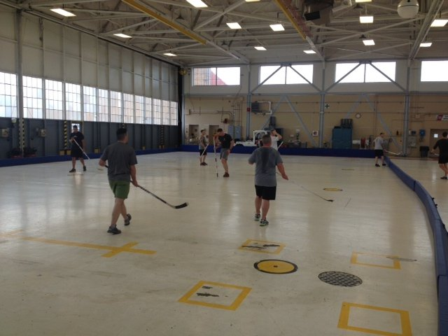 USCG Port Angeles players in a game of floor hockey